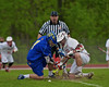 Baldwinsville Bees Evan Stolicker (32) facing off against Cazenovia Lakers <br /> Jake Wozniak (1) in Section III Boys Lacrosse action at the Pelcher-Arcaro Stadium in Baldwinsville, New York on Saturday, May 9, 2015.  Cazenovia won 13-6.
