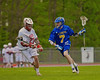 Baldwinsville Bees David Gullen (27) defending against Cazenovia Lakers Teddy Dwyer (7) in Section III Boys Lacrosse action at the Pelcher-Arcaro Stadium in Baldwinsville, New York on Saturday, May 9, 2015.  Cazenovia won 13-6.