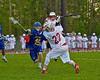 Baldwinsville Bees Jake Anderson (22) winds up for a shot as Cazenovia Lakers defender tries to stop him in Section III Boys Lacrosse action at the Pelcher-Arcaro Stadium in Baldwinsville, New York on Saturday, May 9, 2015.  Cazenovia won 13-6.