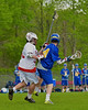 Baldwinsville Bees John Petrelli (33) defending against Cazenovia Lakers Cole Willard (24) in Section III Boys Lacrosse action at the Pelcher-Arcaro Stadium in Baldwinsville, New York on Saturday, May 9, 2015.  Cazenovia won 13-6.