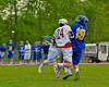 Baldwinsville Bees Matthew Dickman (24) checks Cazenovia Lakers Peter Burr (19) in Section III Boys Lacrosse action at the Pelcher-Arcaro Stadium in Baldwinsville, New York on Saturday, May 9, 2015.  Cazenovia won 13-6.