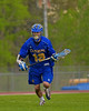 Cazenovia Lakers Peter Burr (19) with the ball against the Baldwinsville Bees in Section III Boys Lacrosse action at the Pelcher-Arcaro Stadium in Baldwinsville, New York on Saturday, May 9, 2015.  Cazenovia won 13-6.