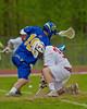 Baldwinsville Bees Evan Stolicker (32) facing off with Cazenovia Lakers Peter Burr (19) to start the game in Section III Boys Lacrosse action at the Pelcher-Arcaro Stadium in Baldwinsville, New York on Saturday, May 9, 2015.  Cazenovia won 13-6.
