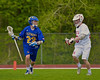 Baldwinsville Bees Ryan Gebhardt (20) defending against Cazenovia Lakers Alex Hunt (22) in Section III Boys Lacrosse action at the Pelcher-Arcaro Stadium in Baldwinsville, New York on Saturday, May 9, 2015.  Cazenovia won 13-6.