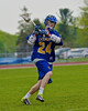 Cazenovia Lakers Cole Willard (24) coming in hot against the Baldwinsville Bees in Section III Boys Lacrosse action at the Pelcher-Arcaro Stadium in Baldwinsville, New York on Saturday, May 9, 2015.  Cazenovia won 13-6.