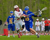 Baldwinsville Bees Patrick Delpha (11) defends against Cazenovia Lakers PJ Brown in Section III Boys Lacrosse action at the Pelcher-Arcaro Stadium in Baldwinsville, New York on Saturday, May 9, 2015.  Cazenovia won 13-6.