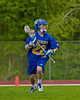 Cazenovia Lakers Alex Hunt (22) cradling the ball against the Baldwinsville Bees in Section III Boys Lacrosse action at the Pelcher-Arcaro Stadium in Baldwinsville, New York on Saturday, May 9, 2015.  Cazenovia won 13-6.