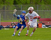 Baldwinsville Bees David Gullen (27) defending against Cazenovia Lakers Alex Hunt (22) in Section III Boys Lacrosse action at the Pelcher-Arcaro Stadium in Baldwinsville, New York on Saturday, May 9, 2015.  Cazenovia won 13-6.
