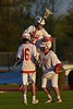 Baldwinsville Bees David Gullen (27) celebrates the Bees win over the Central Square Redhawks with teammates Dawson Giltz (16) and goalie Sean Coe (1) in Section III Boys Lacrosse action at the Pelcher-Arcaro Stadium in Baldwinsville, New York on Thursday, May 7, 2015.  Baldwinsville won 19-6.