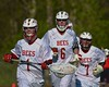Baldwinsville Bees players goalie Sean Coe (1), Charlie Bertrand (6) and Jacob Hannon (7) warm up before playing  the Central Square Redhawks in Section III Boys Lacrosse action at the Pelcher-Arcaro Stadium in Baldwinsville, New York on Thursday, May 7, 2015.