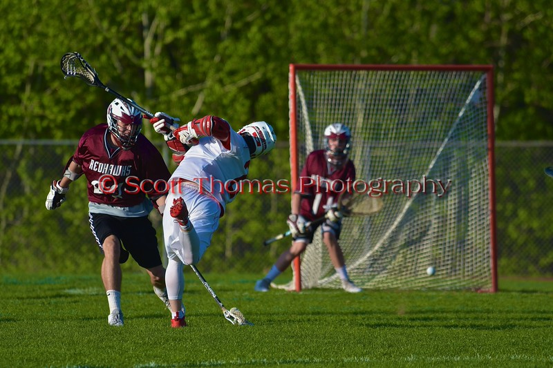 Baldwinsville Bees Jake Anderson (22) fires in a goal against the Central Square Redhawks in Section III Boys Lacrosse action at the Pelcher-Arcaro Stadium in Baldwinsville, New York on Thursday, May 7, 2015.  Baldwinsville won 19-6.