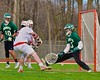 Baldwinsville Bees Charlie Bertrand (6) scores past Fayetteville-Manlius Hornets goalie Thomas Ryu (15) in Section III Boys Lacrosse action at the Pelcher-Arcaro Stadium in Baldwinsville, New York on Friday, May 1, 2015..  Baldwinsville  won 11-9.