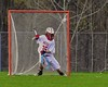 Baldwinsville Bees goalie Riley Smith (35) makes a save against the Fayetteville-Manlius Hornets in Section III Boys Lacrosse action at the Pelcher-Arcaro Stadium in Baldwinsville, New York on Friday, May 1, 2015.  Baldwinsville won 11-9.