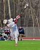 Baldwinsville Bees Jake Anderson (22) fires in a goal against the Fayetteville-Manlius Hornets in Section III Boys Lacrosse action at the Pelcher-Arcaro Stadium in Baldwinsville, New York on Friday, May 1, 2015..  Baldwinsville  won 11-9.
