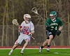 Baldwinsville Bees Connor Smith (26) working against Fayetteville-Manlius Hornets Kyle McGee (34) in Section III Boys Lacrosse action at the Pelcher-Arcaro Stadium in Baldwinsville, New York on Friday, May 1, 2015.  Baldwinsville won 11-9.