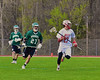 Baldwinsville Bees David Gullen (27) bringing the ball up field against the Fayetteville-Manlius Hornets in Section III Boys Lacrosse action at the Pelcher-Arcaro Stadium in Baldwinsville, New York on Friday, May 1, 2015.  Baldwinsville won 11-9.