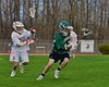 Fayetteville-Manlius Hornets Jeffrey Martin (12) being defended by Baldwinsville Bees Ben Sheehan (28) in Section III Boys Lacrosse action at the Pelcher-Arcaro Stadium in Baldwinsville, New York on Friday, May 1, 2015.  Baldwinsville won 11-9.