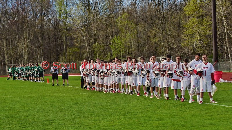 Baldwinsville Bees and Fayetteville-Manlius Hornets players stand for the National Anthem before a Section III Boys Lacrosse game at the Pelcher-Arcaro Stadium in Baldwinsville, New York on Friday, May 1, 2015.
