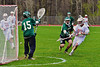 Baldwinsville Bees Connor Smith (26) scores against Fayetteville-Manlius Hornets goalie Brian Charlamb (15) in Section III Boys Lacrosse action at the Pelcher-Arcaro Stadium in Baldwinsville, New York on Friday, May 1, 2015..  Baldwinsville  won 11-9.