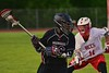 Syracuse Cougars Isiah Spann (26) being defended by Baldwinsville Bees Patrick Delpha (11) in Section III Boys Lacrosse Quarter Final Playoff action at the Pelcher-Arcaro Stadium in Baldwinsville, New York on Wednesday, May 20, 2015.  Syracuse won 12-9.