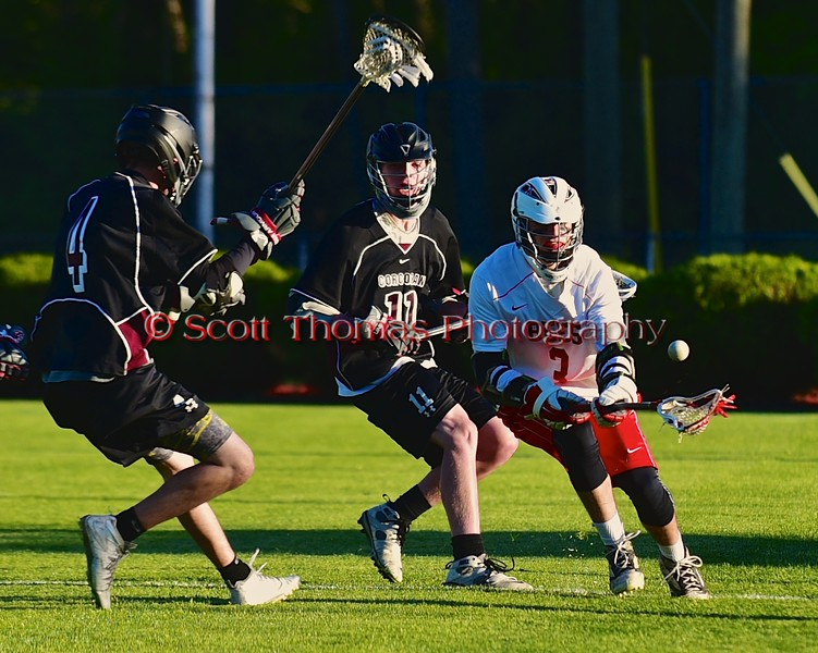 Baldwinsville Bees Matt Abbott (3) goes after a loose ball as Syracuse Cougars Liam Clayton (4) and Matt Eccles (11) defend in Section III Boys Lacrosse Quarter Final Playoff action at the Pelcher-Arcaro Stadium in Baldwinsville, New York on Wednesday, May 20, 2015.  Syracuse won 12-9.