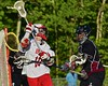 Baldwinsville Bees Dillon Darcangelo (10) gets checked by Syracuse Cougars Emilio Booker (15) in Section III Boys Lacrosse Quarter Final Playoff action at the Pelcher-Arcaro Stadium in Baldwinsville, New York on Wednesday, May 20, 2015. Syracuse won 12-9.