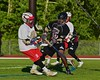 Baldwinsville Bees Dillon Darcangelo (10) gets stopped by Syracuse Cougars Emilio Booker (15) in Section III Boys Lacrosse Quarter Final Playoff action at the Pelcher-Arcaro Stadium in Baldwinsville, New York on Wednesday, May 20, 2015. Syracuse won 12-9.