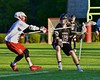 Baldwinsville Bees Patrick Delpha (11) stick checks Syracuse Cougars Sean Eccles (13) in Section III Boys Lacrosse Quarter Final Playoff action at the Pelcher-Arcaro Stadium in Baldwinsville, New York on Wednesday, May 20, 2015. Syracuse won 12-9.