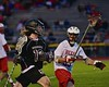 Syracuse Cougars Sean Eccles (13) being watched by Baldwinsville Bees John Petrelli (33) in Section III Boys Lacrosse Quarter Final Playoff action at the Pelcher-Arcaro Stadium in Baldwinsville, New York on Wednesday, May 20, 2015. Syracuse won 12-9.