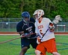 Baldwinsville Bees Charlie Bertrand (6) being defended by Syracuse Cougars Isaiah Robinson (5) in Section III Boys Lacrosse Quarter Final Playoff action at the Pelcher-Arcaro Stadium in Baldwinsville, New York on Wednesday, May 20, 2015.  Syracuse won 12-9.