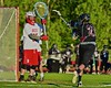 Syracuse Cougars Angel Carrasquillo's (21) shot is stopped by Baldwinsville Bees goalie Riley Smith (35) in Section III Boys Lacrosse Quarter Final Playoff action at the Pelcher-Arcaro Stadium in Baldwinsville, New York on Wednesday, May 20, 2015.  Syracuse won 12-9.