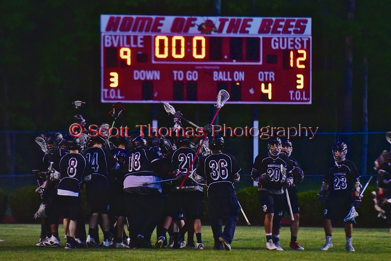 Syracuse Cougars players celebrate their win over the Baldwinsville Bees in the Section III Boys Lacrosse Quarter Final Playoff game at the Pelcher-Arcaro Stadium in Baldwinsville, New York on Wednesday, May 20, 2015.  Syracuse won 12-9.