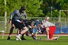 Baldwinsville Bees Evan Stolicker (32) facing off with Syracuse Cougars Sean Eccles (13) in Section III Boys Lacrosse Quarter Final Playoff action at the Pelcher-Arcaro Stadium in Baldwinsville, New York on Wednesday, May 20, 2015. Syracuse won 12-9.