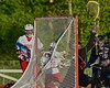 Baldwinsville Bees Charlie Bertrand (6) scores past Syracuse Cougars goalie John DeMott (27) in Section III Boys Lacrosse Quarter Final Playoff action at the Pelcher-Arcaro Stadium in Baldwinsville, New York on Wednesday, May 20, 2015. Syracuse won 12-9.