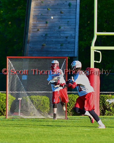 Baldwinsville Bees goalie Riley Smith (35) passes the ball up field to a teammate against the Syracuse Cougars in Section III Boys Lacrosse Quarter Final Playoff action at the Pelcher-Arcaro Stadium in Baldwinsville, New York on Wednesday, May 20, 2015. Syracuse won 12-9.