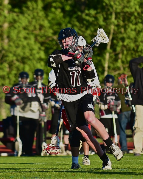 Syracuse Cougars Matt Eccles (11) with the ball against the Baldwinsville Bees in Section III Boys Lacrosse Quarter Final Playoff action at the Pelcher-Arcaro Stadium in Baldwinsville, New York on Wednesday, May 20, 2015.  Syracuse won 12-9.