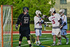 Auburn Maroons Brian Cunningham (16) and Anthony Alberici (25) celebrate Cunningham's goal past Syracuse Cougars goalie John DeMott (27) in the Section III Boys Lacrosse Semi-Final game at the Michael J. Bragman Stadium in Cicero, New York on Saturday, May 23, 2015.  Auburn won 14-6.