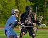 Auburn Maroons Jack Burgmaster (5) checks Syracuse Cougars John Elliot (22) in Section III Boys Lacrosse Semi-Final game at the Michael J. Bragman Stadium in Cicero, New York on Saturday, May 23, 2015.  Auburn won 14-6.