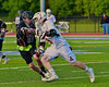 Auburn Maroons Jack Burgmaster (5) avoids a check by Syracuse Cougars Matt Eccles (11) in Section III Boys Lacrosse Semi-Final game at the Michael J. Bragman Stadium in Cicero, New York on Saturday, May 23, 2015.  Auburn won 14-6.