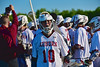Auburn Maroons Trevor Hogan (10) excited for his team's win over the Syracuse Cougars in Section III Boys Lacrosse Semi-Final game at the Michael J. Bragman Stadium in Cicero, New York on Saturday, May 23, 2015.  Auburn won 14-6.