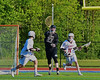 Syracuse Cougars goalie John DeMott (27) passes the ball between Auburn Maroons defenders in Section III Boys Lacrosse Semi-Final game at the Michael J. Bragman Stadium in Cicero, New York on Saturday, May 23, 2015.  Auburn won 14-6.