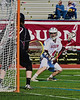 Auburn Maroons Alex Burgmaster (4) lining up a shot at Syracuse Cougars goalie John DeMott (27) in Section III Boys Lacrosse Semi-Final game at the Michael J. Bragman Stadium in Cicero, New York on Saturday, May 23, 2015.  Auburn won 14-6.
