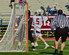 Auburn Maroons Jack Burgmaster (5) has his behind the back shot defended by a Syracuse Cougars player in the Section III Boys Lacrosse Semi-Final game at the Michael J. Bragman Stadium in Cicero, New York on Saturday, May 23, 2015.  Auburn won 14-6.