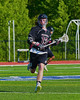 Syracuse Cougars Sean Eccles (13) carrying the ball up field agains the Auburn Maroons in Section III Boys Lacrosse Semi-Final game at the Michael J. Bragman Stadium in Cicero, New York on Saturday, May 23, 2015.  Auburn won 14-6.
