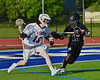 Auburn Maroons Dan Entenmann (18) being defended by Syracuse Cougars Isiah Spann (26) in the Section III Boys Lacrosse Semi-Final game at the Michael J. Bragman Stadium in Cicero, New York on Saturday, May 23, 2015.  Auburn won 14-6.