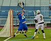 Cicero-North Syracuse Northstars goalie Zach Sheridan (28) makes a save on West Genesee Nick Cunningham (3) in a Section III Boys Lacrosse Semi-Final game at the Michael J. Bragman Stadium in Cicero, New York on Saturday, May 23, 2015.  West Genesee won 13-3.