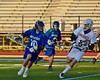 Cicero-North Syracuse Northstars Nick Riccardi (10) being defended by West Genesee Wildcats Ryan McDonald (8) in a Section III Boys Lacrosse Semi-Final game at the Michael J. Bragman Stadium in Cicero, New York on Saturday, May 23, 2015.  West Genesee won 13-3.