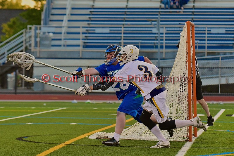 Cicero-North Syracuse Northstars goalie Zach Sheridan (28) out reaches West Genesee Wildcats Nick Cunningham (3) for a loose ball in Section III Boys Lacrosse Semi-Final game at the Michael J. Bragman Stadium in Cicero, New York on Saturday, May 23, 2015.  West Genesee won 13-3.