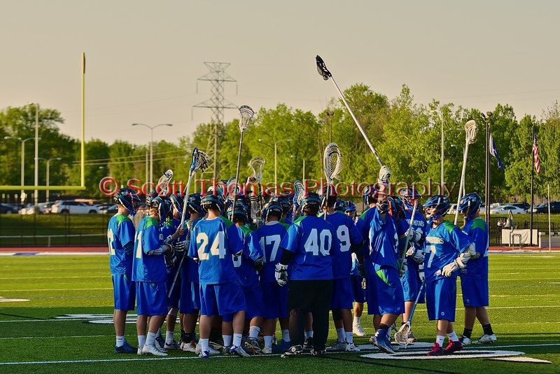 Cicero-North Syracuse Northstars huddle up before playing the West Genesee Wildcats in a Section III Boys Lacrosse Semi-Final game at the Michael J. Bragman Stadium in Cicero, New York on Saturday, May 23, 2015.