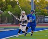 West Genesee Wildcats Nick Cunningham (3) looking to make a play against while being checked by Cicero-North Syracuse Northstars Zach Blake (15) in a Section III Boys Lacrosse Semi-Final game at the Michael J. Bragman Stadium in Cicero, New York on Saturday, May 23, 2015.  West Genesee won 13-3.